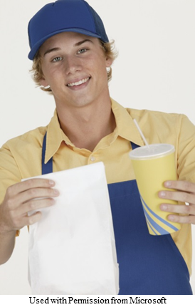 A picture of a food handler holding a takeout bag and cup